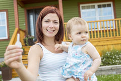 Mother and baby in front of the house royalty free stock image