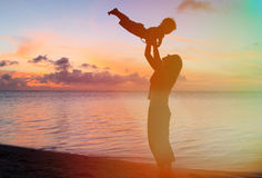 Mother and baby fun at sunset beach Stock Photography