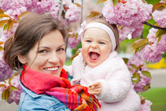 Mother with baby in the garden. Mother with baby in spring garden Stock Image