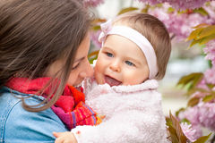 Mother with baby in the garden. Mother with baby in spring garden Royalty Free Stock Image