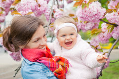 Mother with baby in the garden. Mother with baby in spring garden Royalty Free Stock Photos