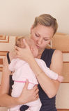Mother and baby girl. Happy mother with baby girl Stock Photos