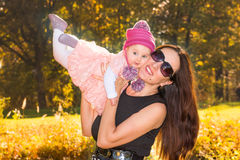 Mother and baby girl in autumn Royalty Free Stock Photography