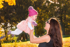 Mother and baby girl in autumn Royalty Free Stock Photos