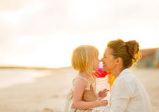Mother and baby girl on beach at the evening Royalty Free Stock Photos