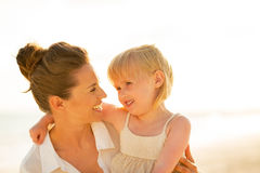 Mother and baby girl on beach at the evening Royalty Free Stock Photography