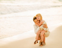 Mother and baby girl on beach at the evening Royalty Free Stock Images