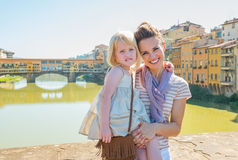 Mother and baby girl on bridge in florence, italy Royalty Free Stock Image
