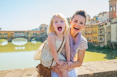 Mother and baby girl on bridge in florence, italy Stock Images