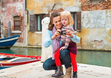 Mother and baby girl checking photos in camera Royalty Free Stock Photography