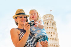 Mother and baby girl checking photos in camera Stock Image