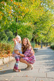 Mother and baby girl in city park Royalty Free Stock Image