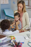 Mother with baby girl at doctor's office Royalty Free Stock Photography