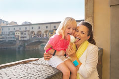 Mother and baby girl eating ice cream in florence Stock Images