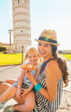 Mother and baby girl eating pizza in pisa Stock Image
