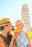 Mother and baby girl eating pizza in pisa Stock Photography