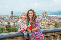 Mother and baby girl with flag in florence Royalty Free Stock Photography