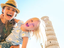 Mother and baby girl in front of tower of pisa Stock Images