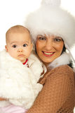 Mother and baby girl in fur clothes Stock Photo