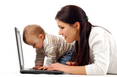 Mother and baby girl having fun with laptop Royalty Free Stock Image