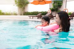 Mother and baby girl having fun in the pool. Summer holidays and. Vacation concept Royalty Free Stock Image