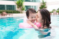 Mother and baby girl having fun in the pool. Summer holidays and. Vacation concept Royalty Free Stock Photography