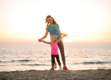 Mother and baby girl having fun time on beach Stock Images