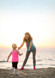 Mother and baby girl having fun time on beach Royalty Free Stock Photos