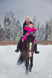 Mother and baby girl horseback riding Royalty Free Stock Images