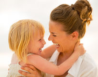Mother and baby girl hugging on beach Royalty Free Stock Images