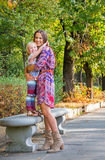 Mother and baby girl hugging in city park Stock Photography