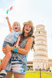 Mother and baby girl with italian flag in pisa Stock Photos
