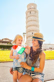 Mother and baby girl with italian flag in pisa Stock Images