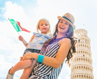 Mother and baby girl with italian flag in Pisa Royalty Free Stock Image