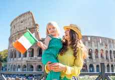 Mother and baby girl with italian flag in rome Stock Photos