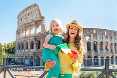 Mother and baby girl with italian flag in rome Royalty Free Stock Photography