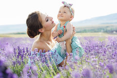 Mother with baby girl in lavender field Royalty Free Stock Photo