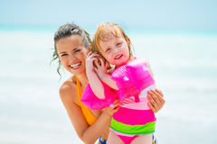 Mother and baby girl listening sound of sea Stock Photography