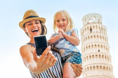 Mother and baby girl making selfie in pisa Royalty Free Stock Images