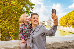 Mother and baby girl making selfie in Rome Royalty Free Stock Image