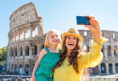 Mother and baby girl making selfie in rome stock photography