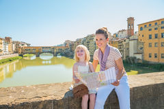 Mother and baby girl with map in florence, italy Stock Photos