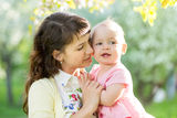Mother with baby girl outdoors Royalty Free Stock Images