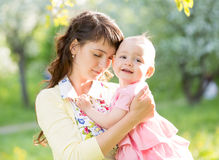 Mother with baby girl outdoors Royalty Free Stock Photo