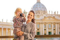 Mother and baby girl with photo camera  in vatican Stock Photos