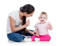 Mother and baby girl play. Loving mother playing with her baby girl Royalty Free Stock Photo