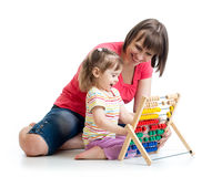 Mother and baby girl play with counter toy Stock Photo