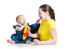 Mother and baby girl play musical toys Royalty Free Stock Images