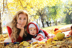 Mother and baby girl playing in autumn park royalty free stock images