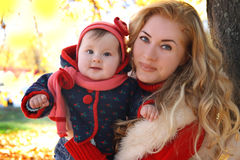 Mother and baby girl playing in autumn park Stock Photography